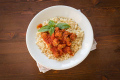 Fregola with tomato sauce and sausage Royalty Free Stock Image