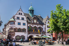 Freiburg Germany. A plaza and a typical historical house with a bronze tower Stock Images