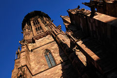 Freiburg Minster, a medieval church in the city of Freiburg, at the edge of the Black Forest, Germany. World famous Freiburg Minster cathedral, a medieval church Royalty Free Stock Images