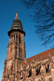 Freiburg Minster, a medieval church in the city of Freiburg, at the edge of the Black Forest, Germany. World famous Freiburg Minster cathedral, a medieval church Stock Photo