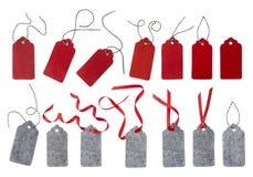Freie Marke mit rotem Farbband Geschenkaufkleber Aufkleber vom roten und grauen Filz Lizenzfreie Stockbilder