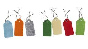 Freie Marke mit rotem Farbband Geschenktags lokalisiert auf weißem Hintergrund Lizenzfreies Stockfoto