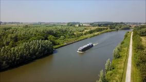 A freight barge on a river stock video