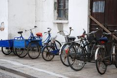 Parking lot for freight bicycles in Zhujiajiao. Freight Bicycles on  a  parking  lot in front of the water town  Zhujiajiao, China Royalty Free Stock Photography