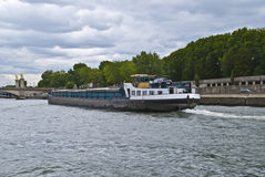 Freight boat on the Seine. Royalty Free Stock Photo
