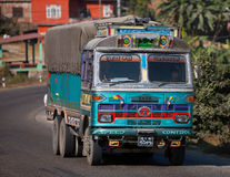 Freight car. Kathmandu Valley in Nepal a few on the road is not large, often decorated with colorful cargo truck convoy traveling Royalty Free Stock Image