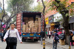 Freight car in the loading and unloading of goods. In Shenzhen Baoan Xixiang commercial pedestrian street, China royalty free stock images