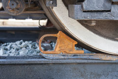 Freight car is secured with brake shoe Stock Photography