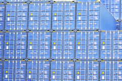 Freight cargo containers. Stacked freight cargo containers closeup Stock Photography