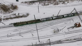 Freight, cargo train passing railroad station in winter. Aerial shoot. stock video