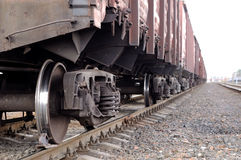 Freight cargo train and railroad. Railway road and close up view from lower camera angle of freight cargo train Stock Image