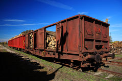 Freight carriage full of timber Stock Photos
