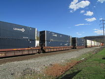 Freight cars with containers in West Haverstraw, NY. Royalty Free Stock Images