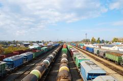 Freight cars!. Goods, wagon, wagons, vans, carriage, carriages, railway, rail, railroad, cisterns, tanks, transit, transportation, conveyance, station, different Royalty Free Stock Photography