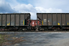 Freight Cars. An interesting view of three freight cars of the Alaska Railroad on a siding in Anchorage, Alaska under beautiful clouds Stock Photos