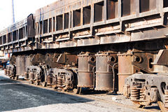 Freight cars at the railway station. Wheels and wheel truck with three axles Royalty Free Stock Images