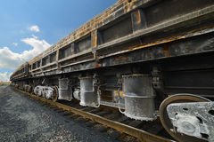 Freight cars at the railway. Wheels and wheel truck with three axles Stock Photography