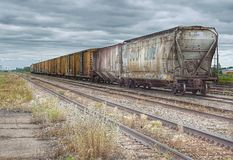 Freight Cars In Saskatchewan, Canada. Several freight cars sit idle on a rail siding in the province of Saskatchewan in Canada stock photos