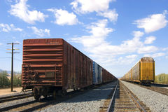 Freight Cars sitting on Tracks. Parked railroad freight cars sitting on tracks in desert Royalty Free Stock Photos