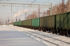 Freight cars at the station. In winter Royalty Free Stock Photo