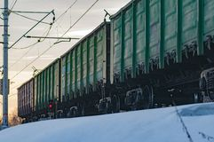 Freight cars in the winter. Railway freight train on a winter evening Stock Photos