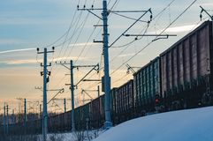 Freight cars in the winter. Railway freight train on a winter evening Stock Photo
