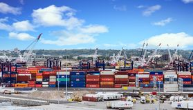 Freight Containers at Shipping Dock. Freight shipping operation at a commercial dock stock photo
