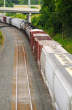 Freight on curve. A freight train rounding a curve, seen from above Royalty Free Stock Photography
