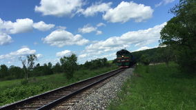 Freight green train traveling on the railroad. The  Freight green train traveling on the railroad stock footage
