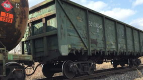 Freight green train traveling on the railroad stock footage