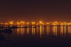 Freight harbor at night with lights reflection Royalty Free Stock Images