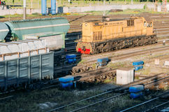 Freight locomotive couples the wagons, at the railway station. Royalty Free Stock Image