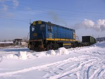 Freight locomotive train on the rails of the industrial railway in the winter stock photo