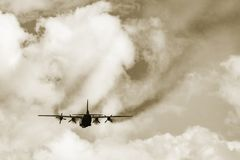 Freight military plane. Freight military plane in the cloudy sky Royalty Free Stock Photo