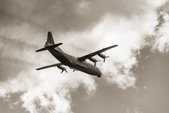 Freight military plane. Freight military plane in the cloudy sky Royalty Free Stock Image