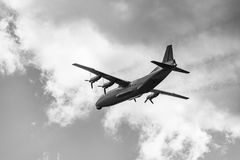 Freight military plane. Freight military plane in the cloudy sky Stock Photo