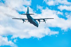 Freight military plane. Freight military plane in the cloudy sky Stock Images