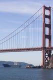 Freight Portrait. A large ship passes beneath the Golden Gate Bridge Stock Photography