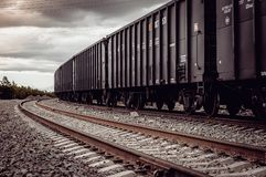 Freight rail cars go on rails. In Russia Royalty Free Stock Photos