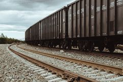 Freight rail cars go on rails. In Russia Stock Photo