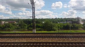 Freight railway station. United cargo and passenger transfer point from the window of a passing train stock video footage