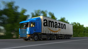 Freight semi truck with Amazon.com logo driving along forest road, seamless loop. Editorial 4K clip. Freight semi truck with Amazon.com logo driving along forest stock video footage