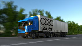 Freight semi truck with Audi logo driving along forest road, seamless loop. Editorial 4K clip. Freight semi truck with Audi logo driving along forest road stock video