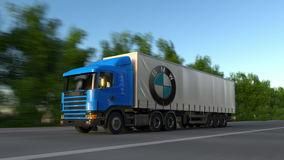 Freight semi truck with BMW logo driving along forest road, seamless loop. Editorial 4K clip. Freight semi truck with BMW logo driving along forest road stock video