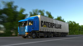 Freight semi truck with Caterpillar Inc. logo driving along forest road, seamless loop. Editorial 4K clip. Freight semi truck with Caterpillar Inc. logo driving stock footage