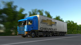 Freight semi truck with Chevrolet logo driving along forest road, seamless loop. Editorial 4K clip. Freight semi truck with Chevrolet logo driving along forest stock video footage