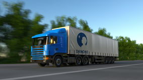 Freight semi truck with Danone logo driving along forest road, seamless loop. Editorial 4K clip. Freight semi truck with Danone logo driving along forest road stock video footage