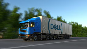Freight semi truck with Dell Inc. logo driving along forest road. Editorial 3D rendering Royalty Free Stock Image