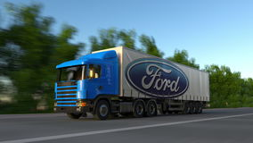 Freight semi truck with Ford Motor Company logo driving along forest road, seamless loop. Editorial 4K clip. Freight semi truck with Ford Motor Company logo stock video footage