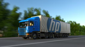 Freight semi truck with HP Inc. logo driving along forest road. Editorial 3D rendering Royalty Free Stock Photography